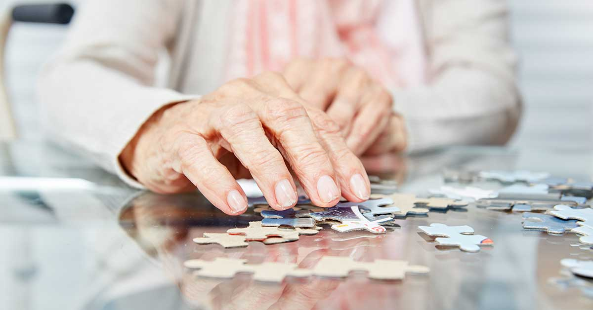 Woman doing a jigsaw puzzle