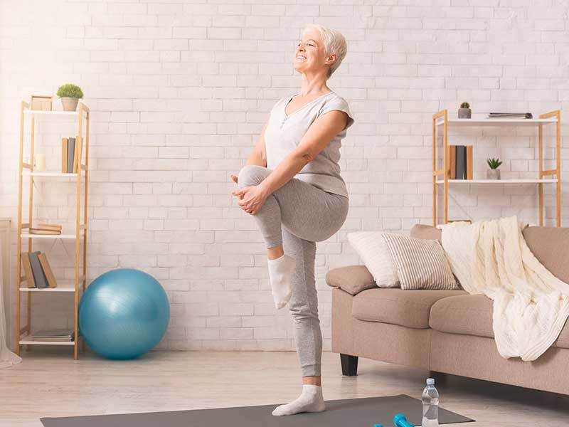 older woman balancing