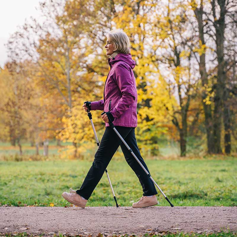Older woman striding out in the park