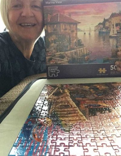 Dianne with completed jigsaw