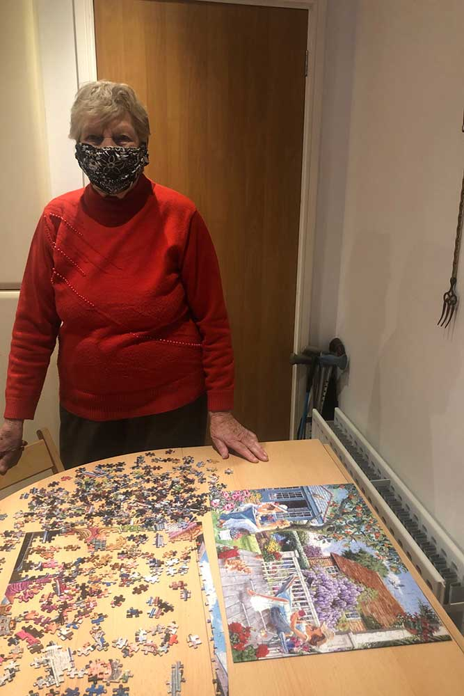Enid age 92 and her completed jigsaw