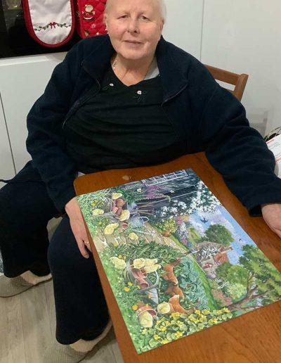 Jennifer with finished jigsaw