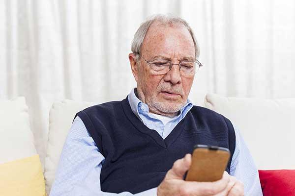 older man texting